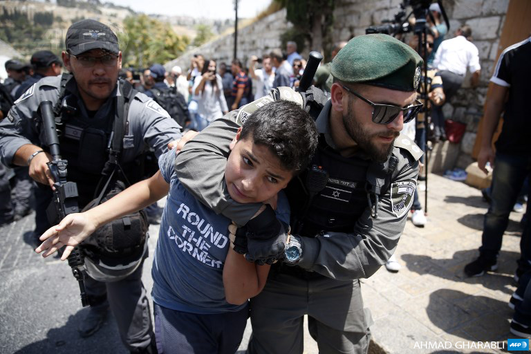 Israeli border guards detain a Palestinian youth during a demonstration outside Lions Gate, a main entrance to Al-Aqsa mosque compound, in Jerusalem's Old City on July 17. (Photo: AFP / Ahmad Gharabli)