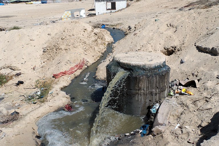 A sewage outlet is located approximately 200 meters (219 yards) from Hossam cafeteria, next to where the al-Sayes family swam at sunset on July 19, 2017. (Photo: DCIP / Mohammad Abu Rukbeh)