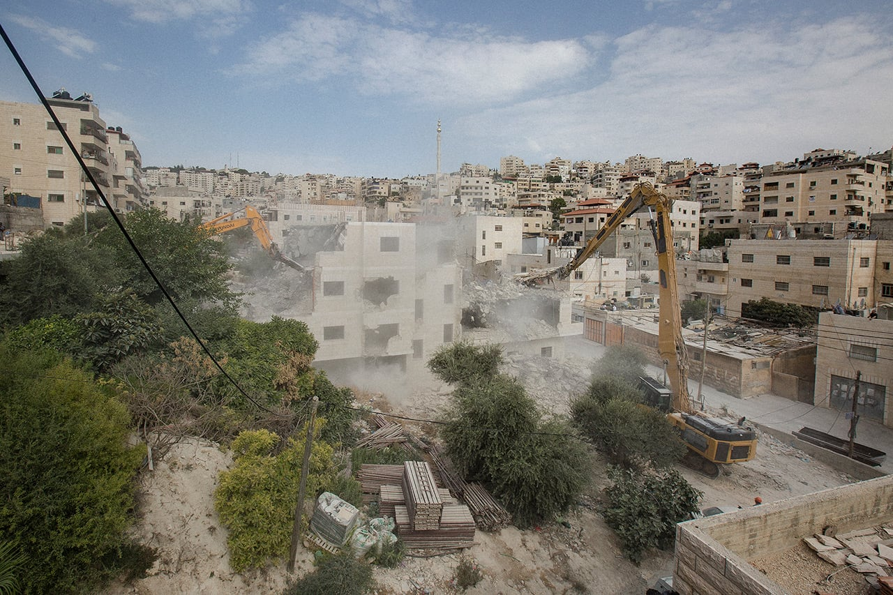 A demolition of a four story Palestinian building takes place in the Isawwiya neighborhood of East Jerusalem in July 2017. (Photo: Faiz Abu Rmeleh)