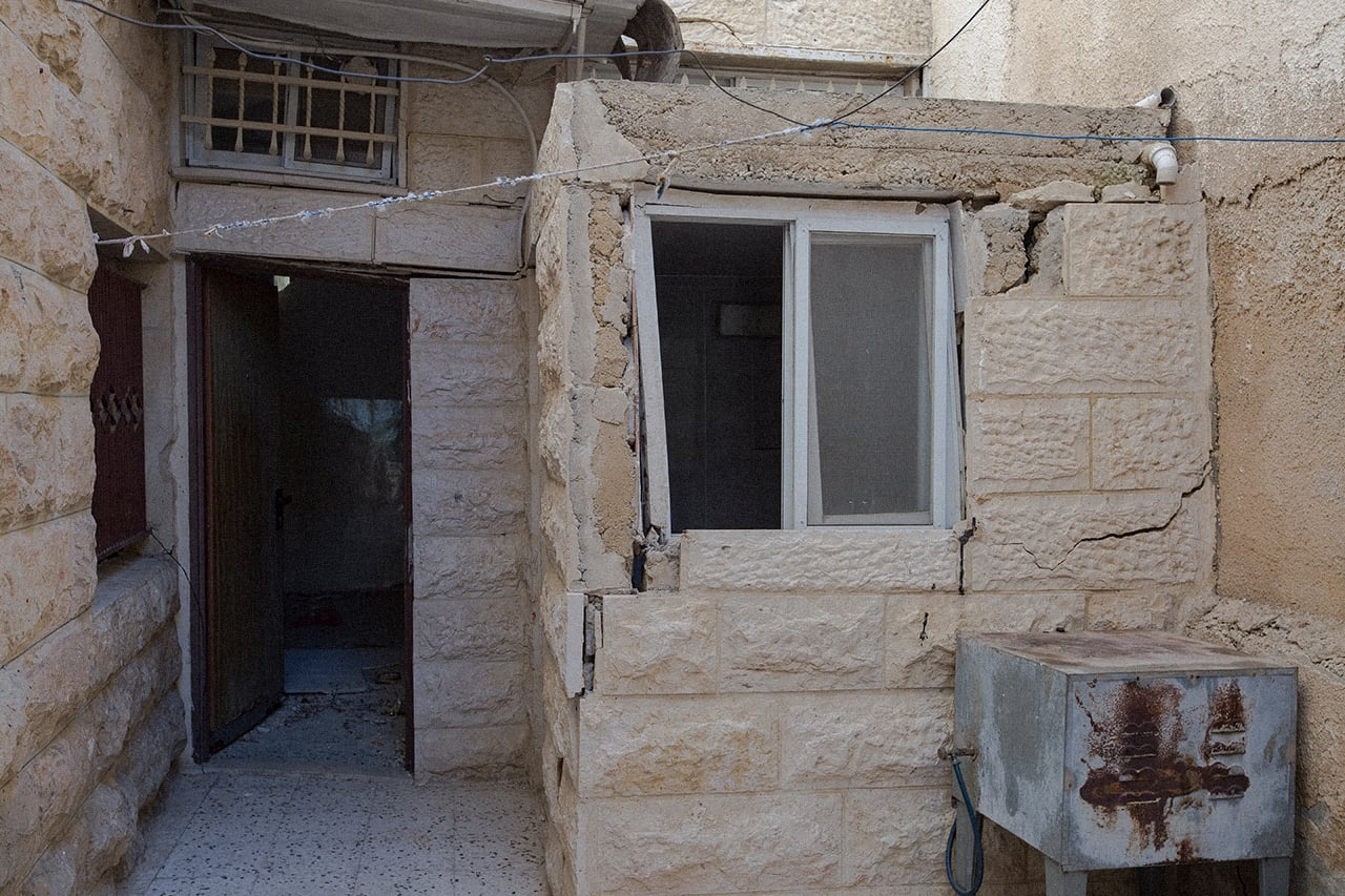 Large cracks, separated and buckling walls can be seen on interior and exterior walls of the Abu Rmeileh's family home. (Photo: Faiz Abu Rmeleh)