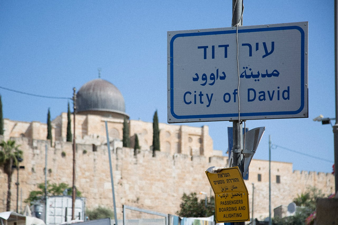 "View of Al-Aqsa mosque from the south near an Israeli street sign for the ""City of David"" in Hebrew, Arabic and English. (Photo: Faiz Abu Rmeleh)"