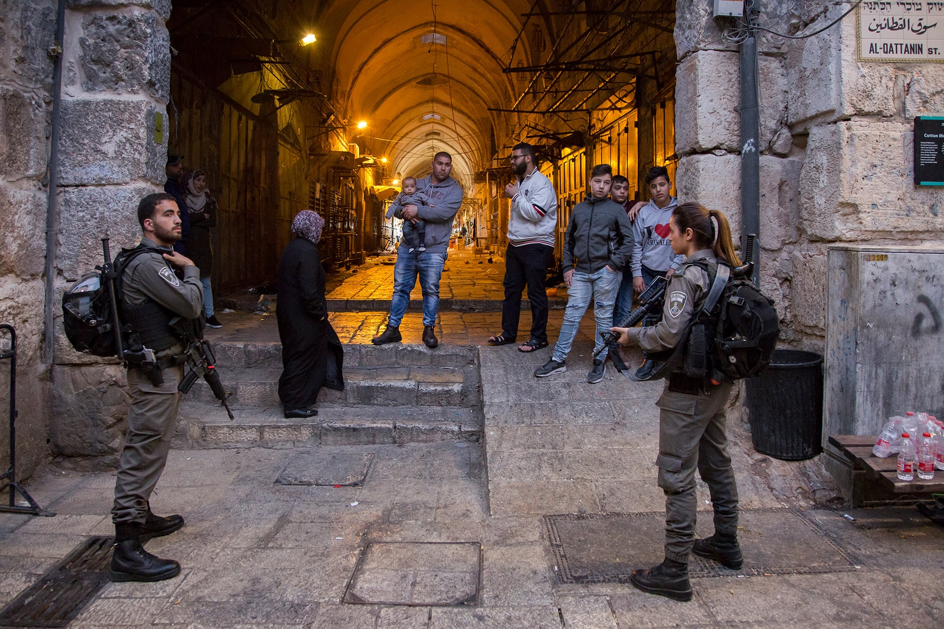 Israeli forces prevent Palestinians from exiting Al-Qattanin market on March 14, 2018, in the Old City of Jerusalem. (Photo: Faiz Abu Rmeleh)