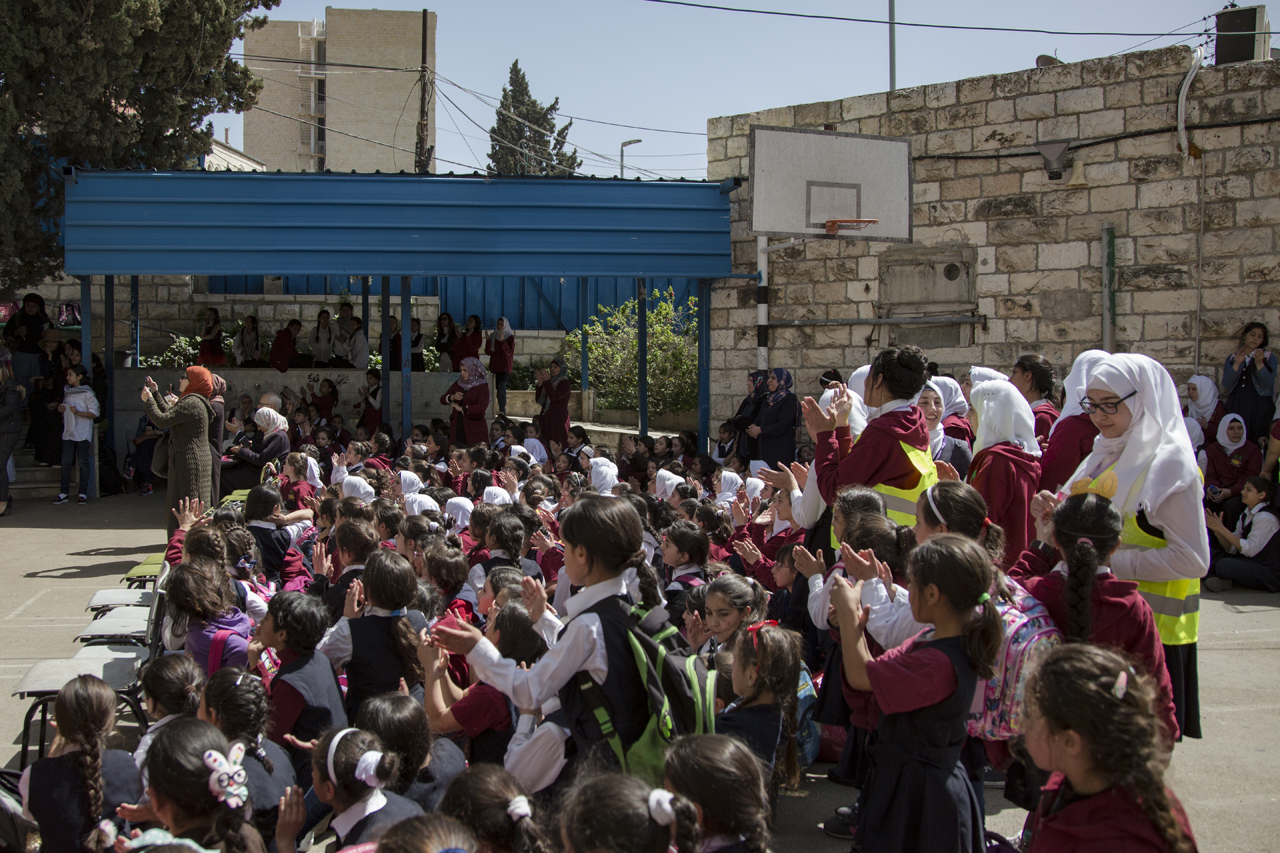 Students in a Sheikh Jarrah school in East Jerusalem celebrate International Mothers' Day on March 22, 2018. (Photo: DCIP / Faiz Abu Rmeleh)