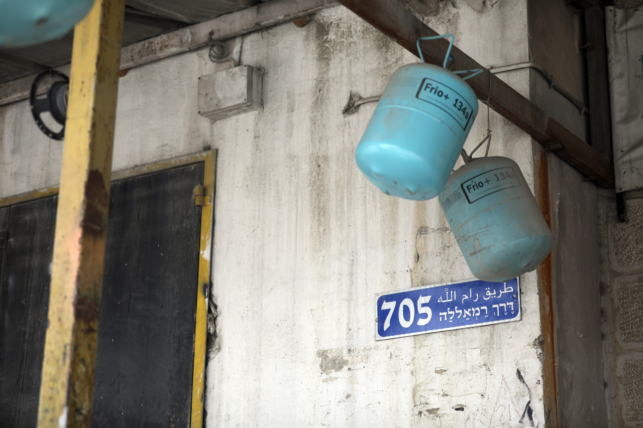 Refrigerant cylinders hang on a beam outside of a home in Kufr Aqab. (Photo: DCIP / Elia Ghorbiah)