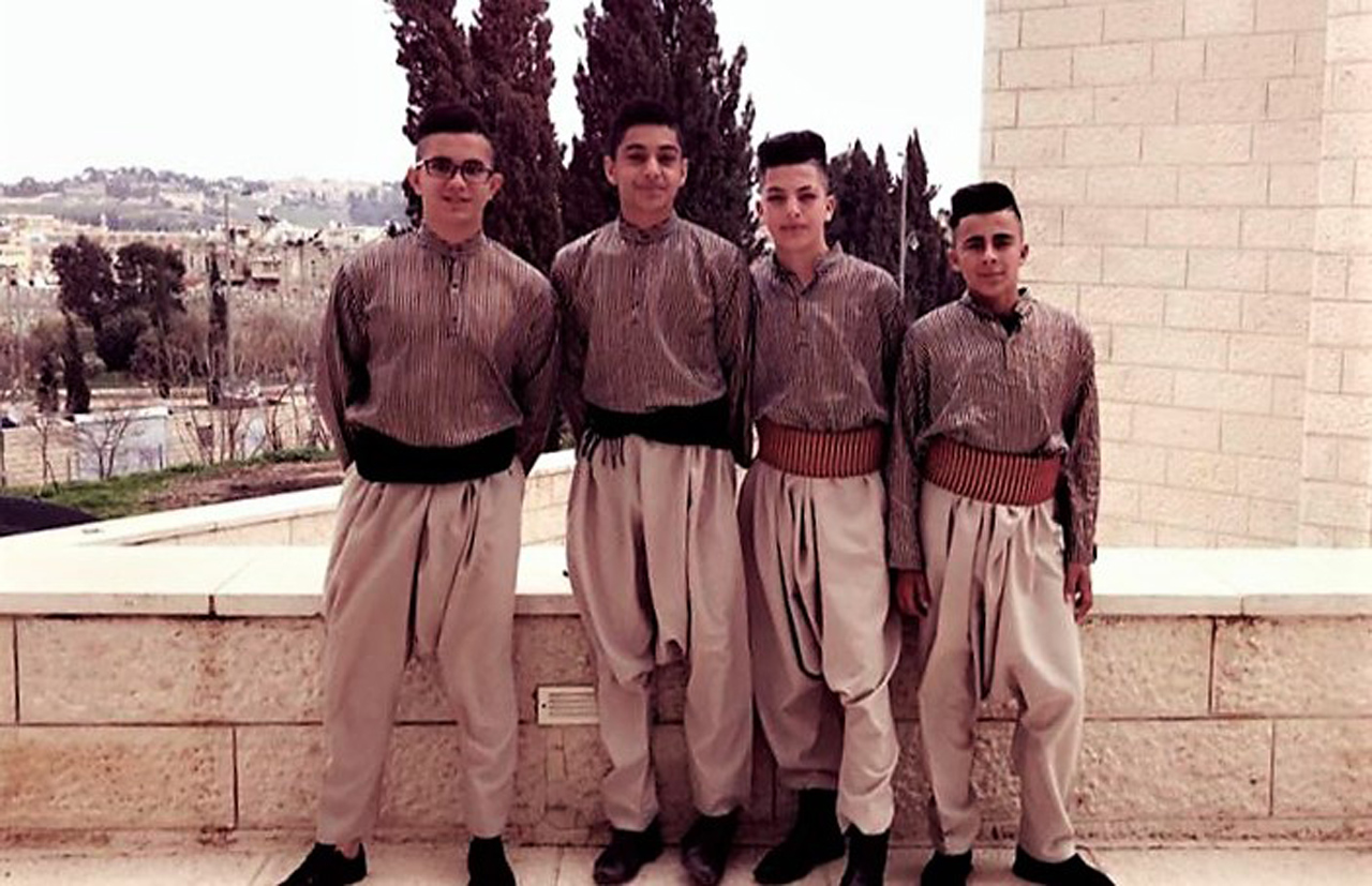 Ghaleb and his teammates line up for a photo in their performance costumes. (Photo: Courtesy of Al-Hakawati theater)