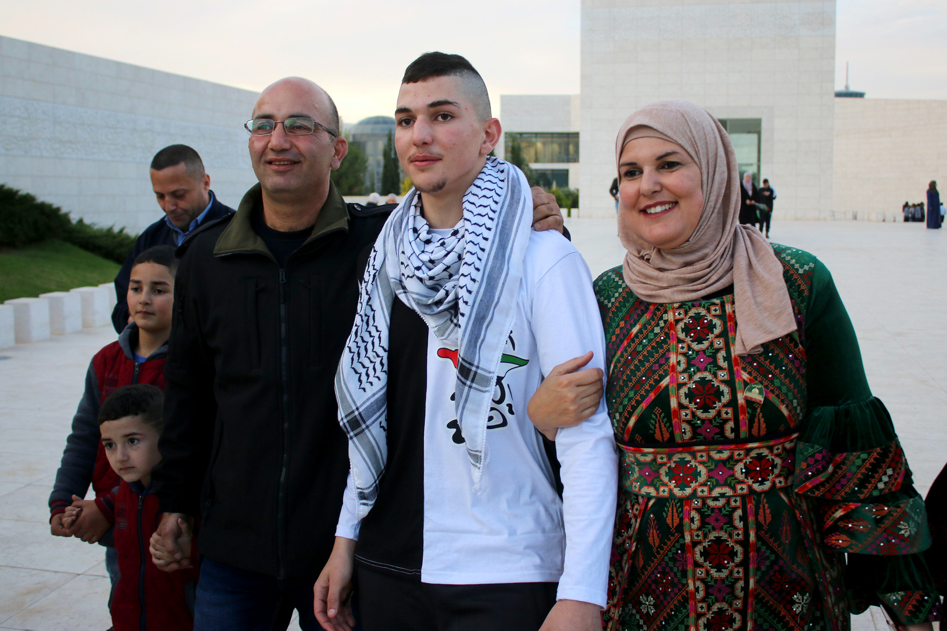 The family of Shadi Farrah, 15, greets him on November 29, 2018 as he arrives in Ramallah city after serving almost three years in an Israeli prison. (Photo: ActiveStills / Ahmad Al-Bazz)