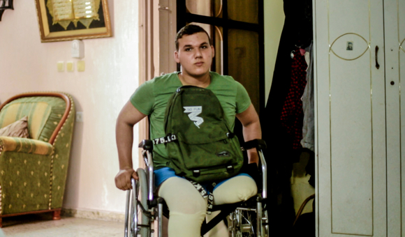 Abdullah Q., 16, was struck by live fire on May 14,  2018, during Great March of Return protests in central Gaza. (Photo: DCIP / Saud Ramadan)