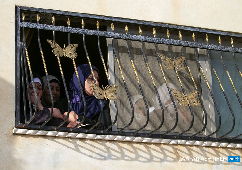 Palestinian women look on during the funeral of Mohammed Hamayel, 15, in Beita village, south of Nablus in the occupied West Bank on March 11, 2020. (Photo: AFP / Jaafar Ashtiyeh)