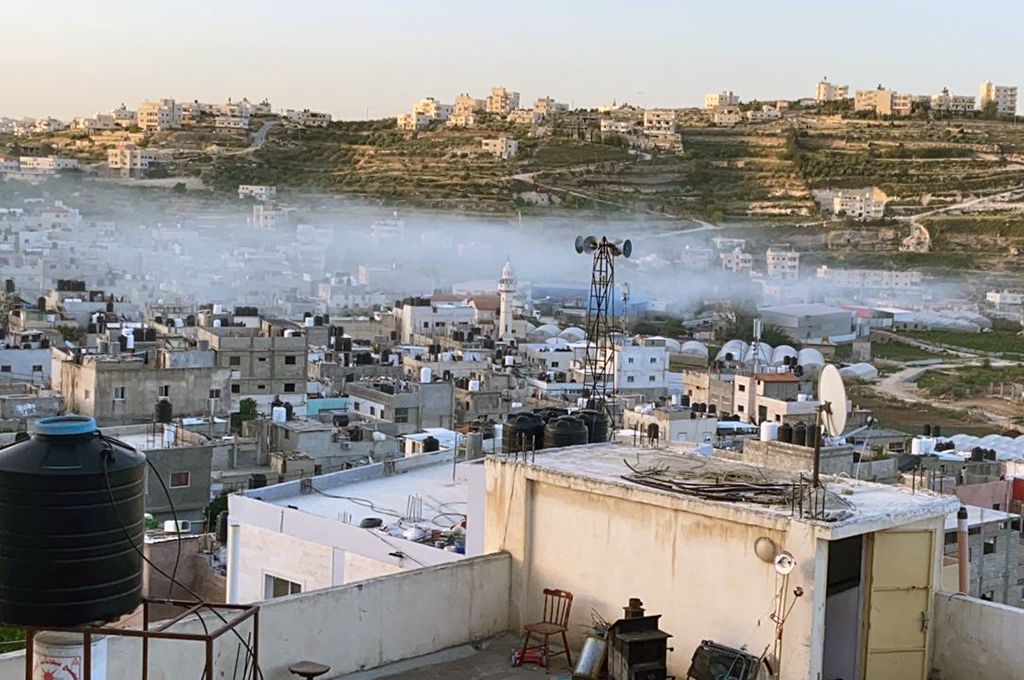 A blanket of Israeli-fired tear gas covers Al-Fawwar refugee camp near Hebron while Israeli forces conduct a military raid on May 13, 2020.