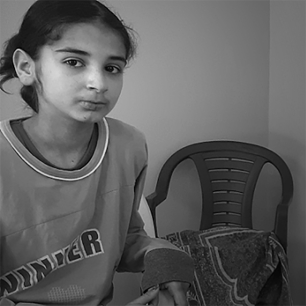 Islam Abu Baker, 13, sits in her family home in occupied West Bank town of Yabad on July 11, 2020. (Photo: DCIP)