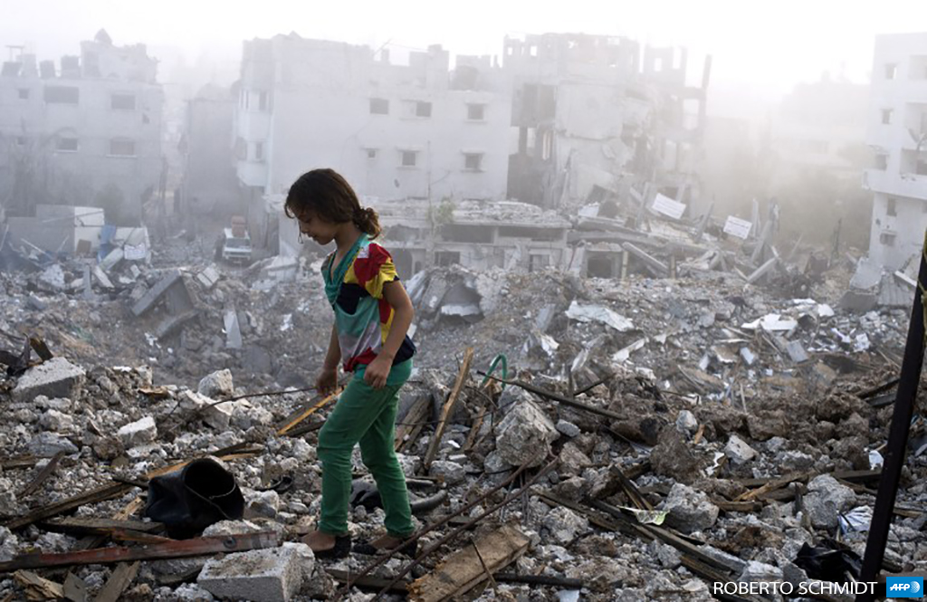 A Palestinian girl walks on the rubble of her family's home after she and other members of her family returned to their partially destroyed house early on August 27, 2014 in Gaza City's Shuja'iyya neighborhood. (Photo: AFP / Roberto Schmidt)