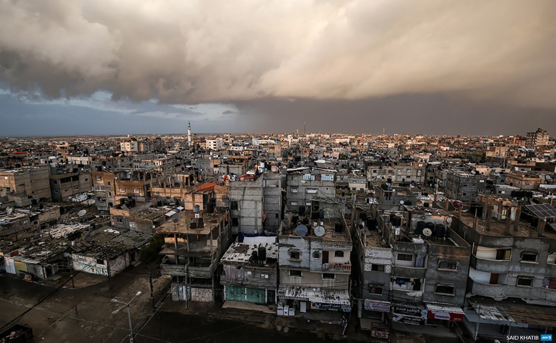 Elevated view in city of Rafah shows a rain storm in the distance at sunset in the southern Gaza Strip on January 21, 2020. (Photo: AFP / Said Khatib)