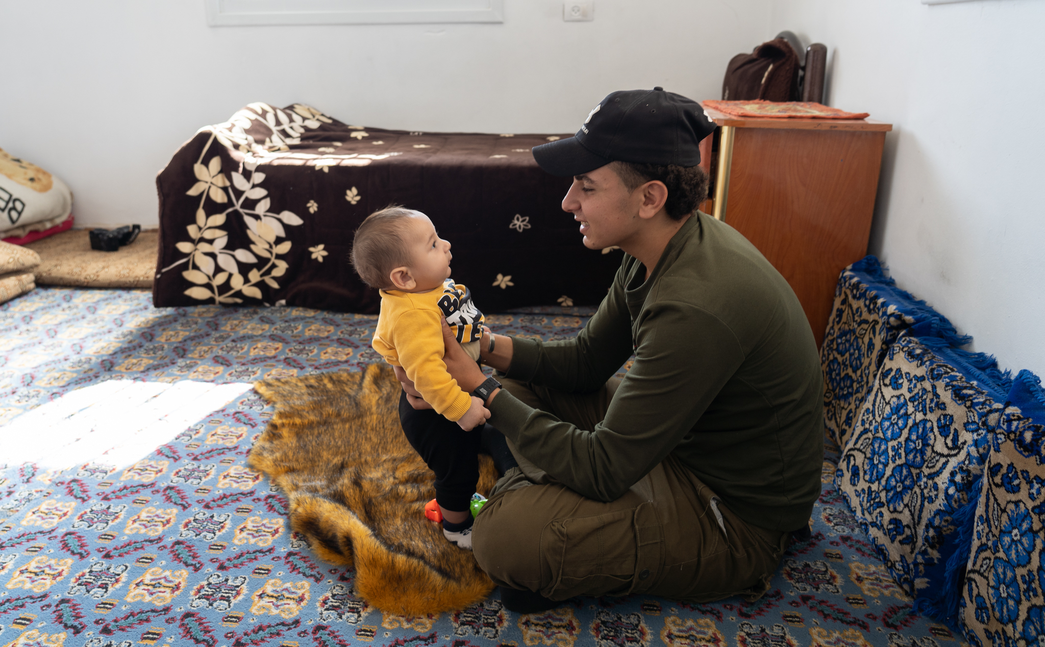 Ismail plays with his baby brother in the family home in Beit Fajjar village in the occupied West Bank. (Photo: DCIP)