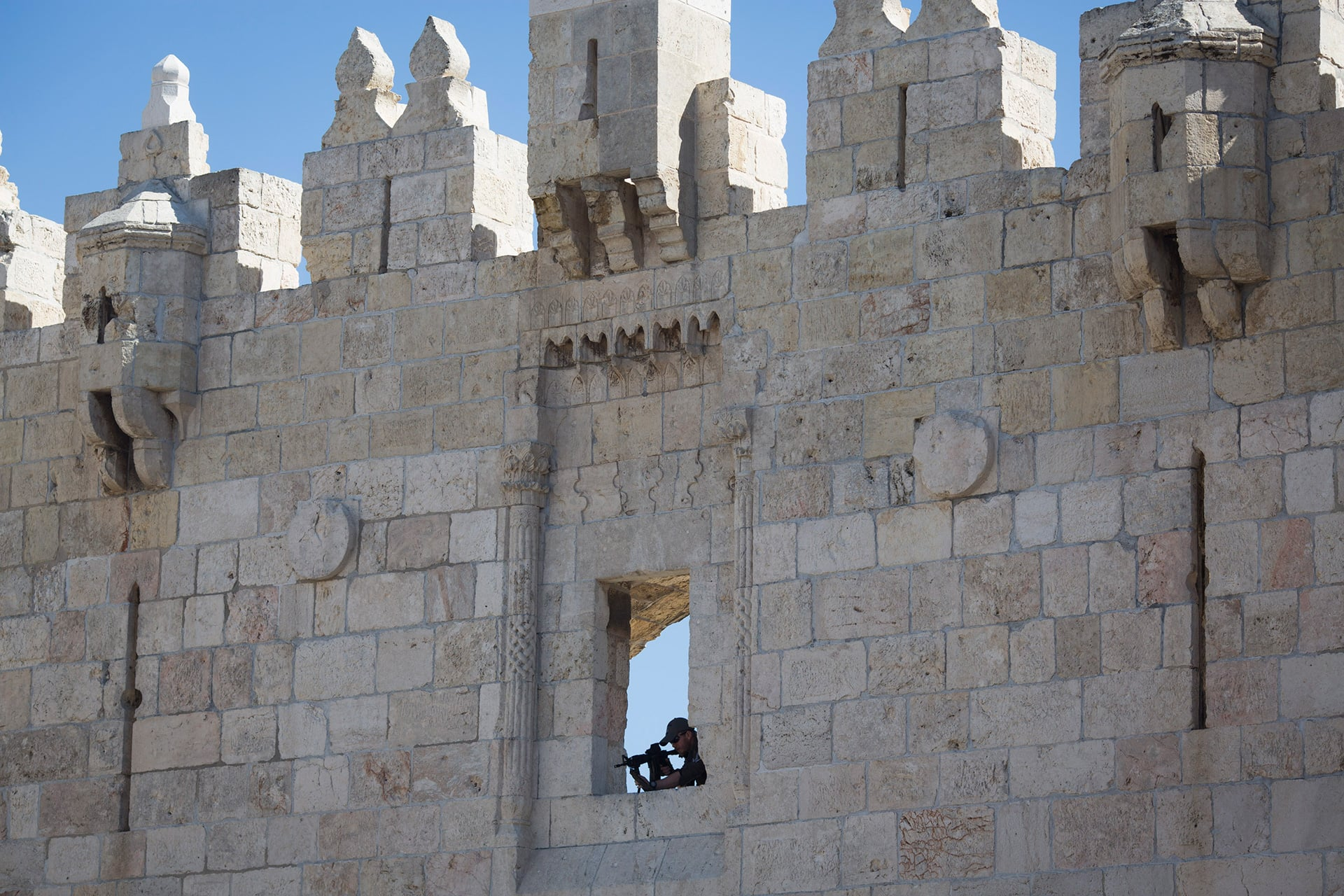 An Israeli anti-riot police sniper observes the surrounding from a wall of the Damascus Gate in Jerusalem's old city, February 17,  2016. (Photo: ActiveStills / Oren Ziv)