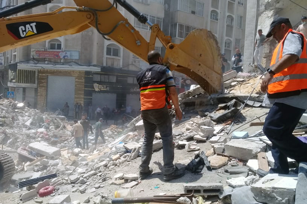 Palestinian search and rescue crews dig through the rubble in search of survivors and victims of Israeli airstrikes on Gaza City that left 30 dead, including 11 children early on May 16. (Photo: DCIP / Mohammad Abu Rukbeh)