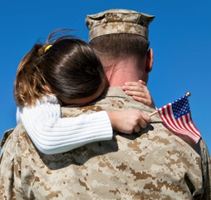 Military with child holding a flag
