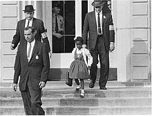 220px-US_Marshals_with_Young_Ruby_Bridges_on_School_Steps.jpg