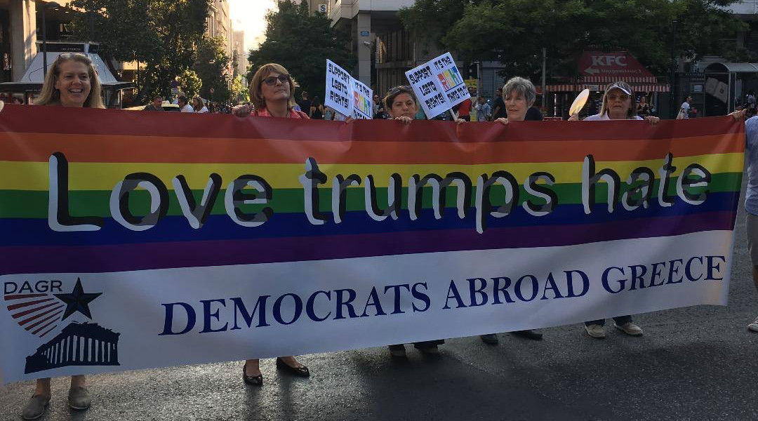 2018_Pride_group_Marching_with_banner_cropped.jpg