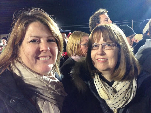 Kristi with her mom at a 2012 Denver campaign rally for Barrack Obama.