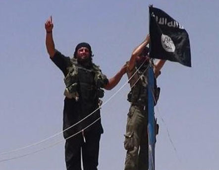 An-image-from-the-jihadist-Twitter-account-Al-Baraka-news-on-June-11-2014-allegedly-shows-militants-from-ISIL-hanging-the-Islamic-Jihad-flag-AFP.jpg