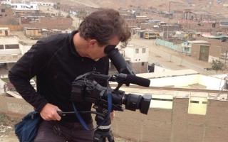 Filmmaker Rustin Thompson shooting on location
