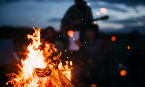 People are seen by a fire.