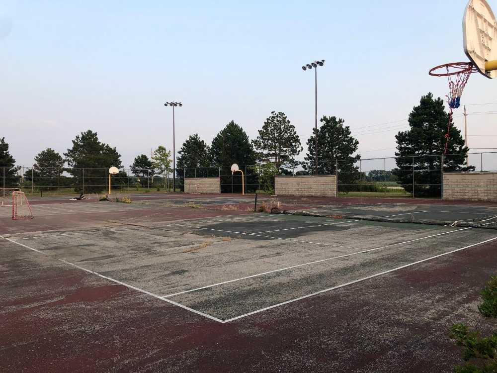 The dilapidated tennis courts at St. Thomas of Villanova.