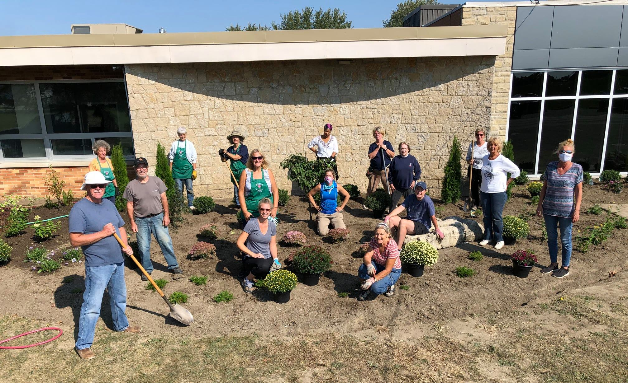 Members Amherstburg's Fort Malden Horticultural Society outside the Signature Garden outside the community hub