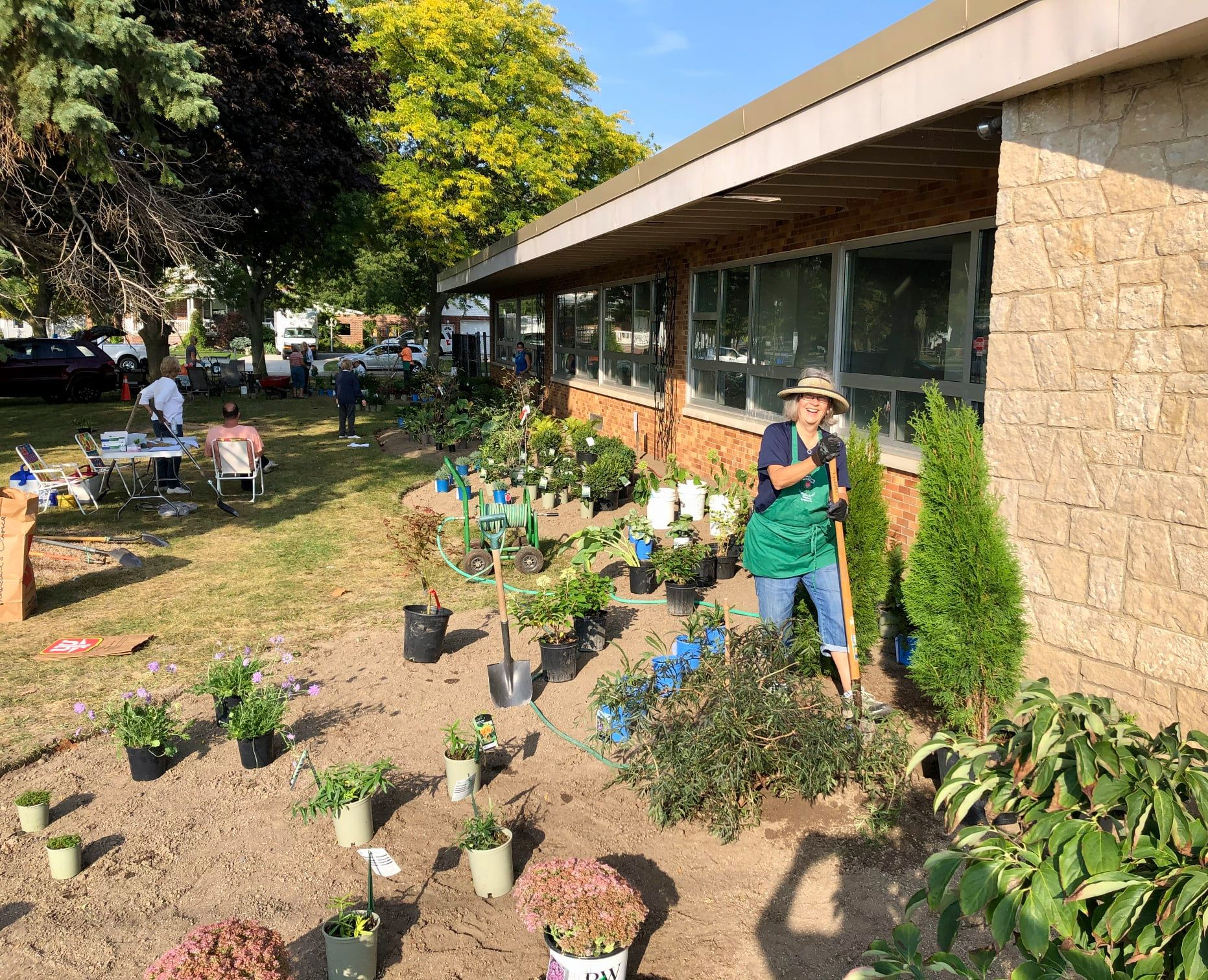 Members of Amherstburg's Fort Malden Horticultural Society outside the community hub.