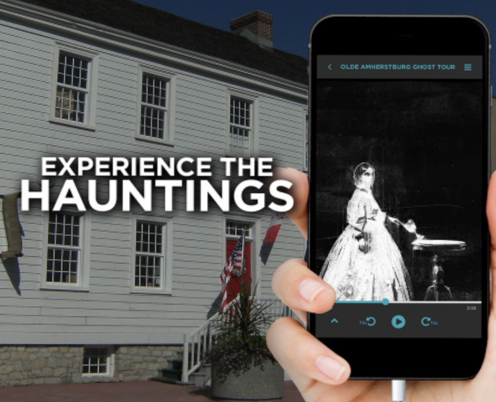A ghost on a smartphone in front of Gordon House