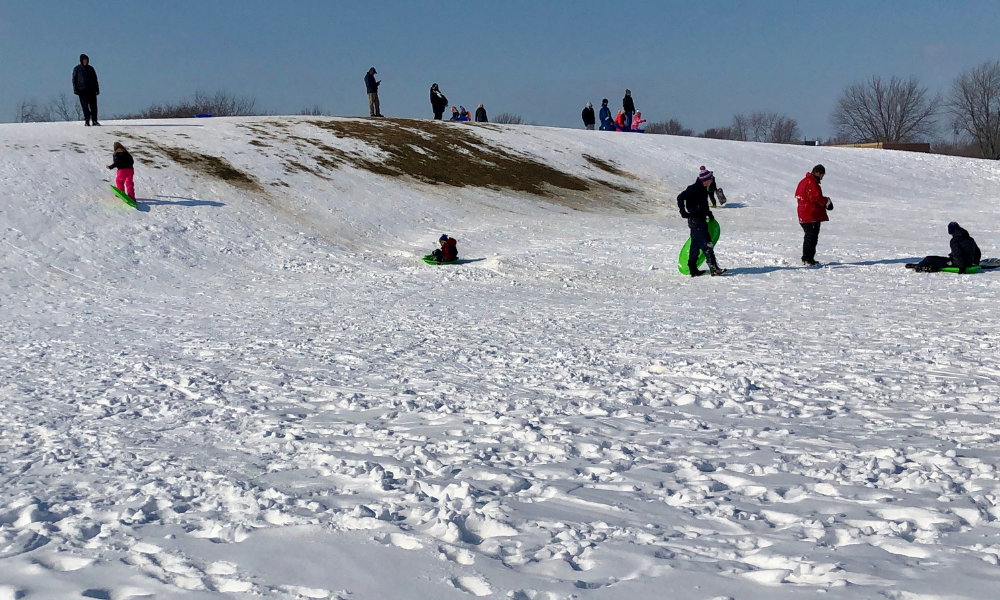 Children sled on Russell Renaud Hill in Amherstburg