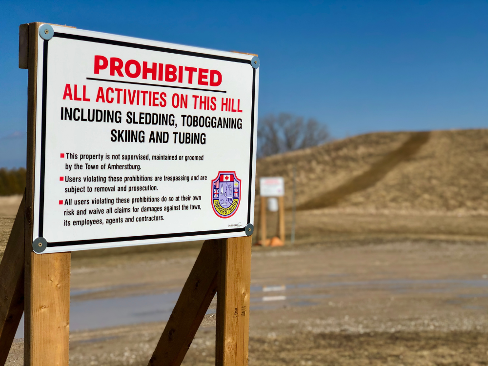 A sign at the base of the Libro Hill informs people they are using the hill at their own risk.