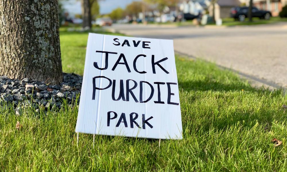 A Save Jack Purdie Park sign