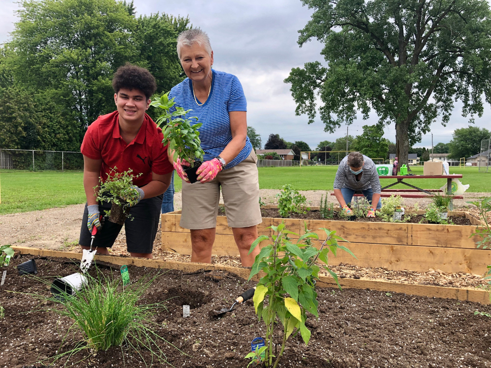 Bo O'Rourke-Caton and Mary Caton at the community garden in Amherstburg.
