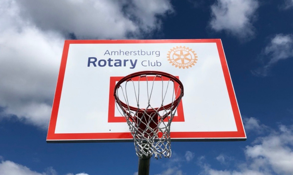A basketball backboard with the Rotary of Amherstburg logo