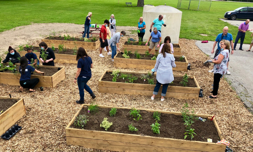 Residents work on the community garden at the hub