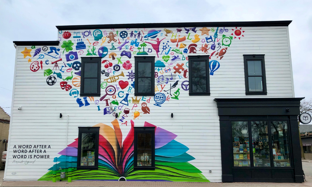 The mural on the east wall of River Bookshop