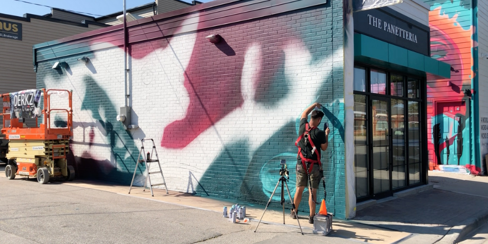 Derks works on his mural in downtown Amherstburg