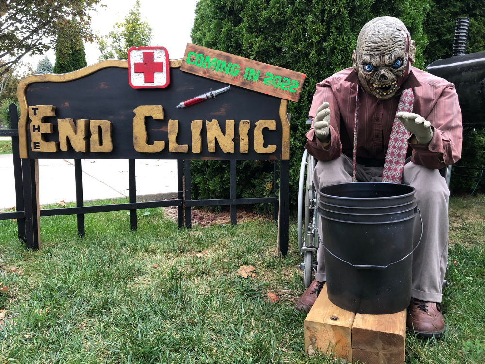 A monster in front of a sign reading The End Clinic