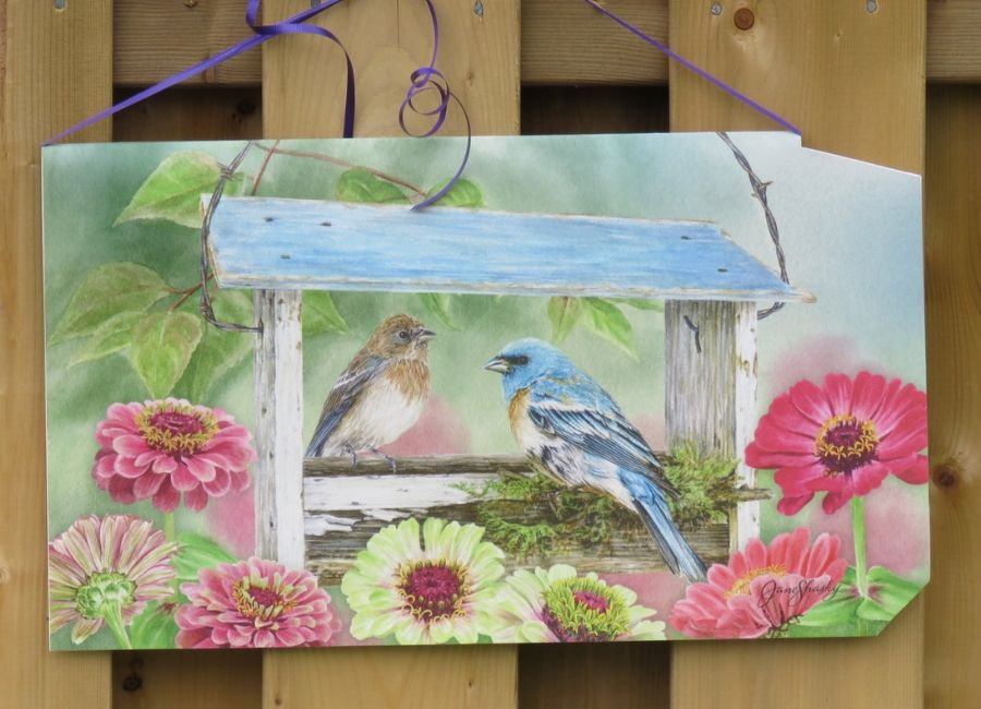 Birds on a painted mailbox cover