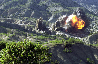 British Royal Engineers of Task Force Jacana destroy a cave complex on the border between the Paktika and Paktia provinces in Afghanistan on May 10, 2002, during Operation Snipe. This was reportedly the largest explosion set off by the Royal Engineers since World War II.