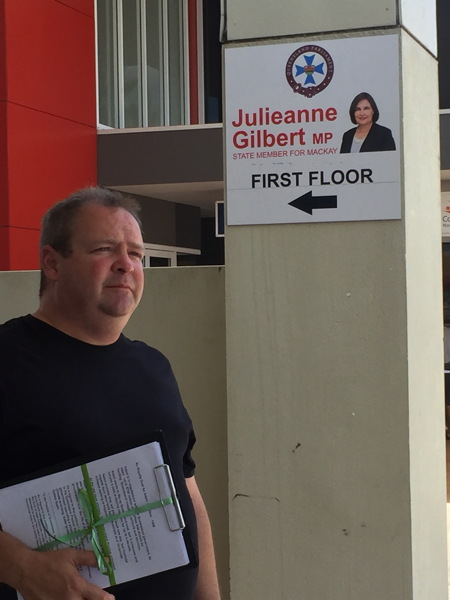 Michael Kane delivering petition to Julieanne Gilbert