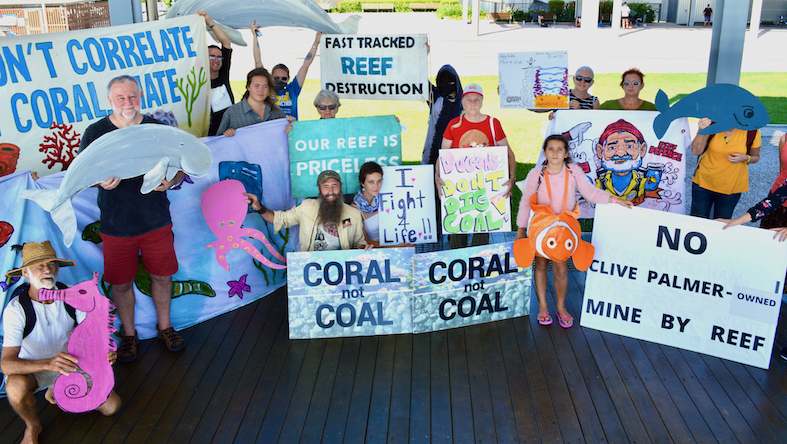 Mackay Rally For Our Reef community members with signs and reef themed props