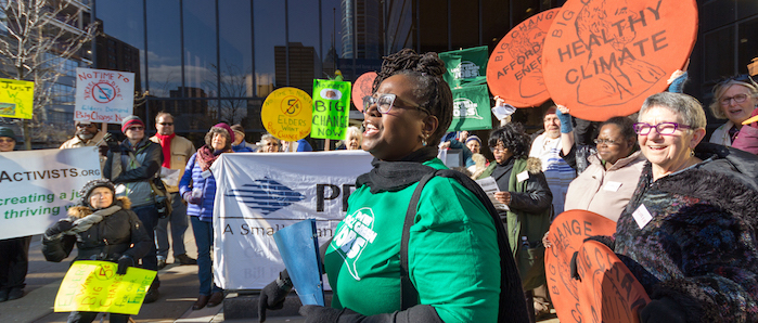 Rev. Rhetta Morgan leads a Power Local Green Jobs action