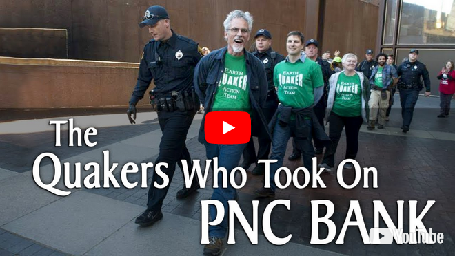 Videostill of police leading four hand-cuffed but proud Earth Quaker Action Team activists out of a PNC Bank branch. Title reads: The Quakers who took on PNC Bank.