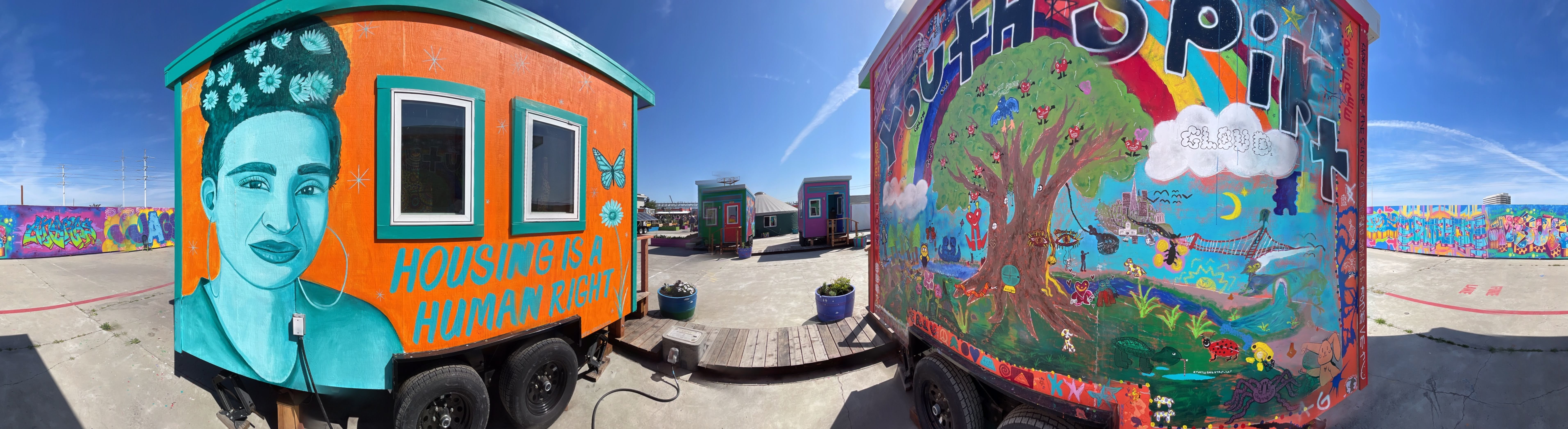 Two trailers with murals at YSA's Youth Empowerment Tiny Home Village