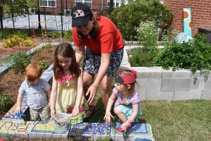 Young members of Saint Paul's UMC Creation Care ministry learn about being good stewards of God's earth. Cara Fleischer, Creation Care Leader, helped children release 10,000 ladybugs into the organic church garden to help it thrive without pesticides. The harvest is donated to Manna on Meridian food bank.