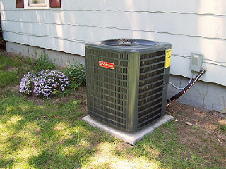Put your air-conditioner in the shade or plant a tree next to it to provide shade.