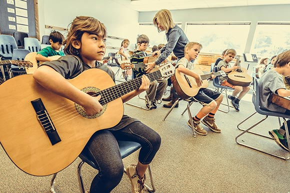 Kids playing guitars