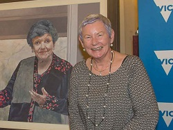 Kay Setches with portrait of Joan Kirner